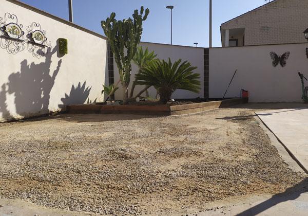 rellenar terreno con gravilla y arena